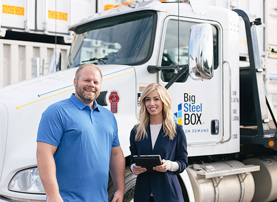 BigSteelBox staff with a container delivery truck