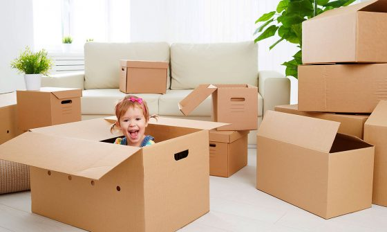 Child with moving boxes - Moving tips for parents